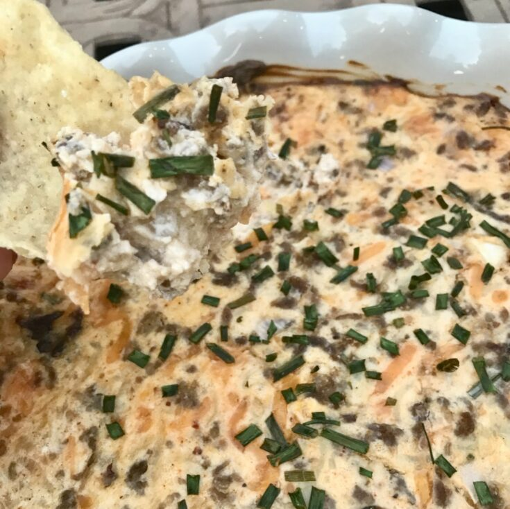 Best Tailgate Sausage Dip is the perfect heavy dip for any kind of party or get together. Made with smoky sausage it will be the favorite at your next tailgate or party! #tailgating #dips #sausagedip