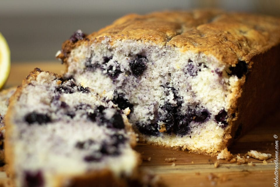 close up picture of sliced blueberry cake