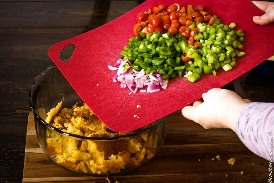 adding vegetables to bacon cornbread salad