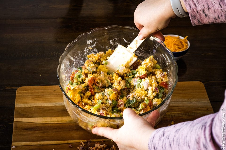 mixing bacon cornbread salad
