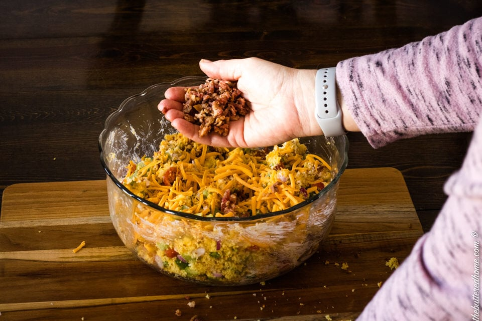 adding bacon to bacon cornbread salad