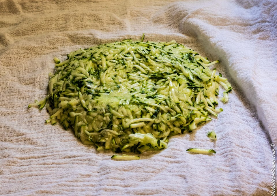 grated zucchini ready to squeeze water out