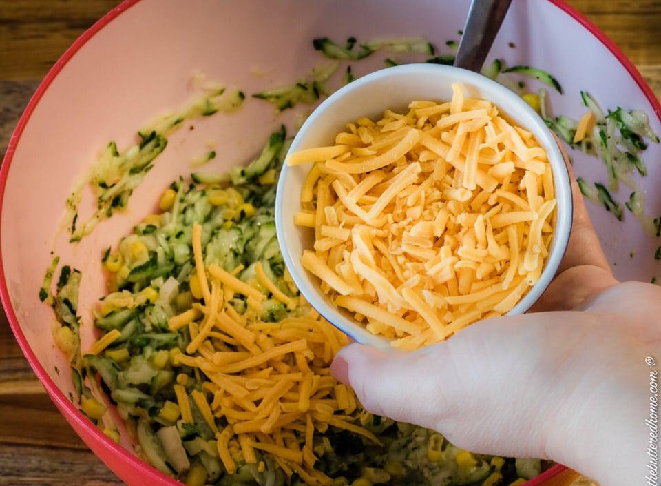 adding grated cheese for zucchini cornbread