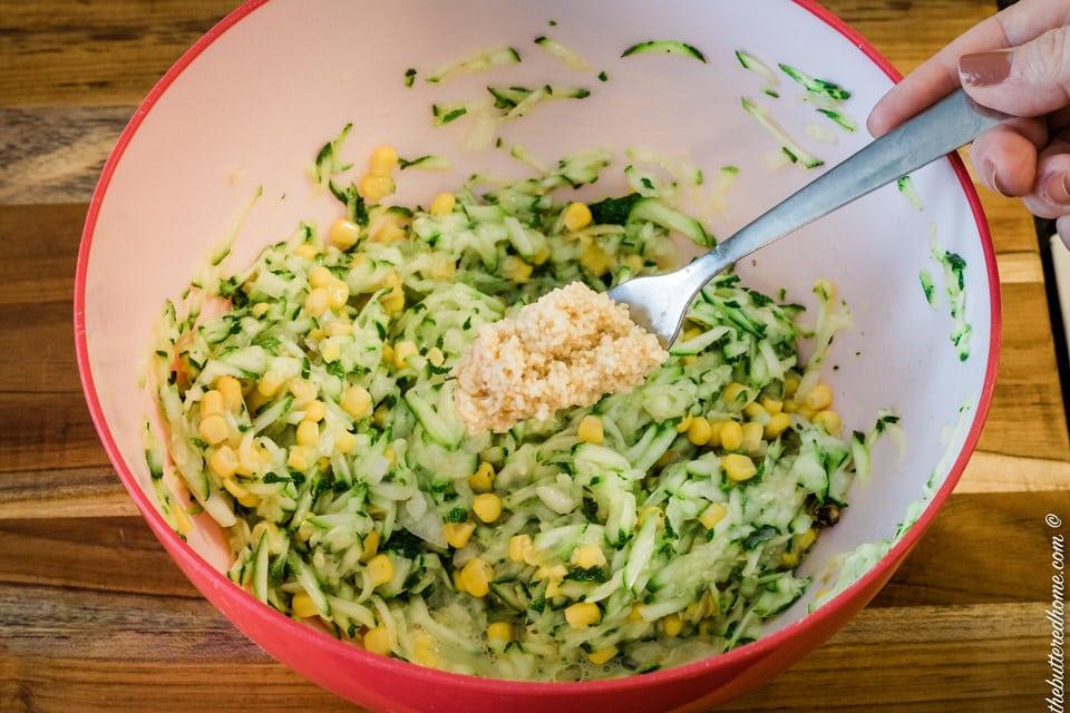 adding garlic for zucchini cornbread
