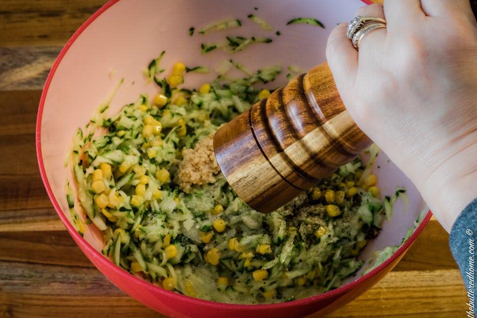 adding pepper for zucchini cornbread