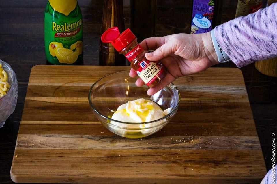 adding smoked paprika to macaroni salad dressing