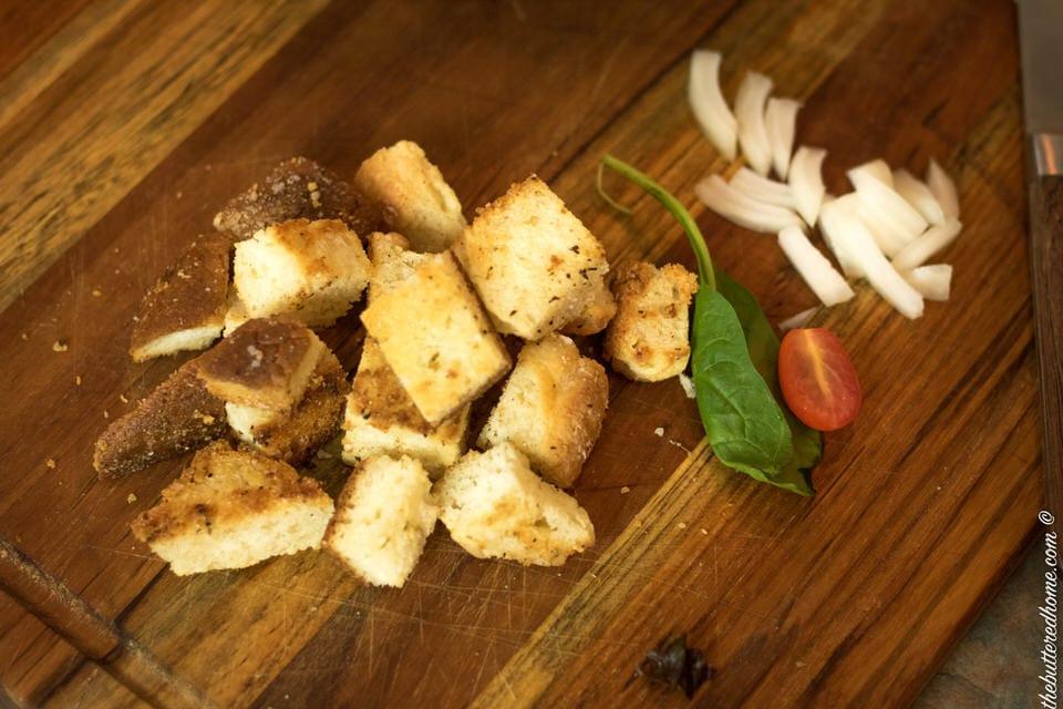 homemade croutons for salad on a cutting board