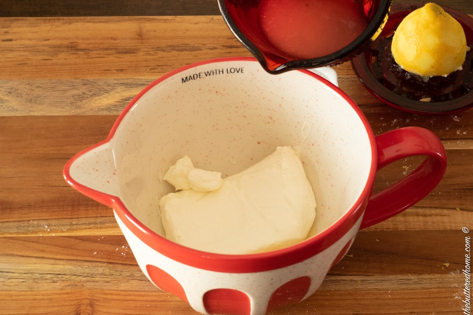 adding lemon juice to cream cheese