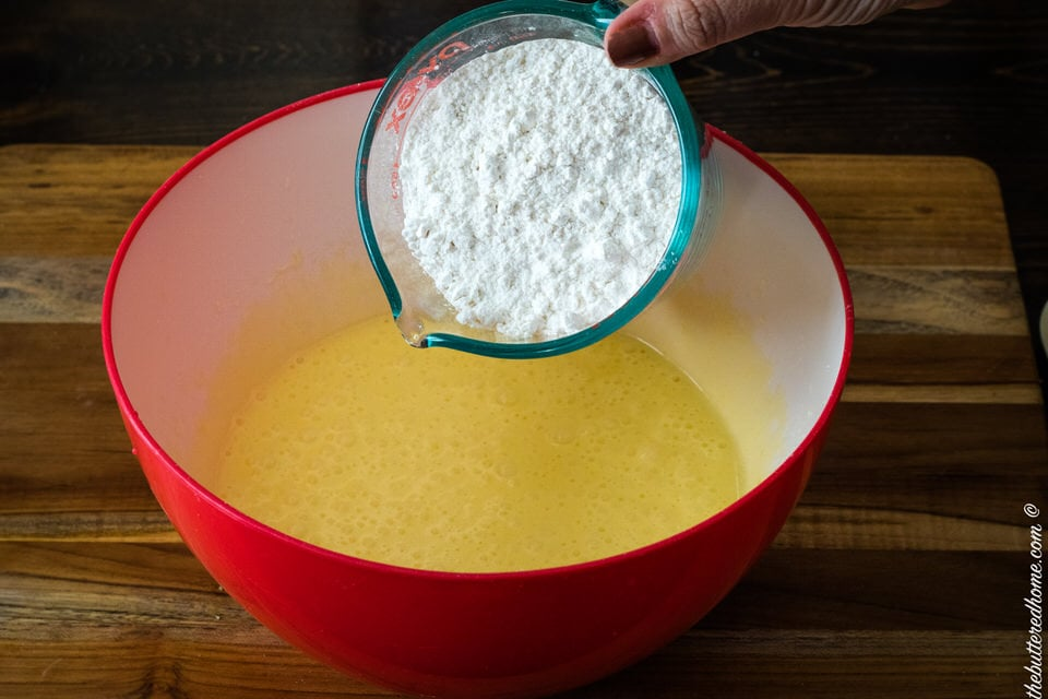 flour going in strawberry upside down cake