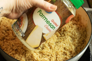 adding parmesan cheese to rice