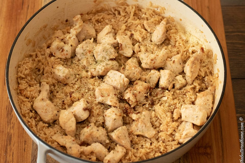 close up of skillet of chicken and rice