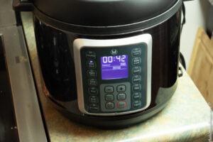 electric pressure cooker with time set to 42 minutes