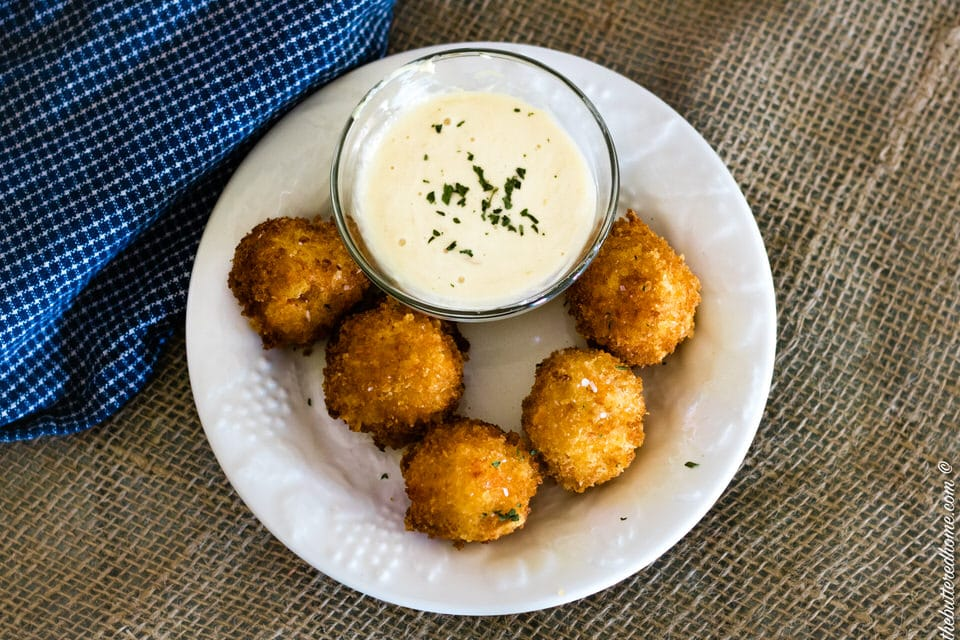 fried pimento cheese balls on a plate with a horseradish dip
