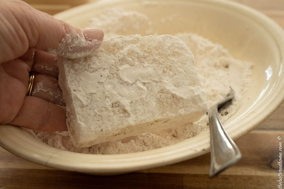 cut frozen grit cakes rolled in flour mixture