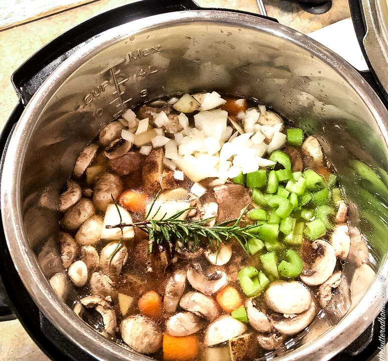rosemary added to cooking pot