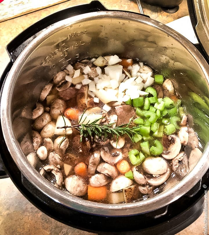 mushrooms, rosemary, carrots and celery and onion in instant pot