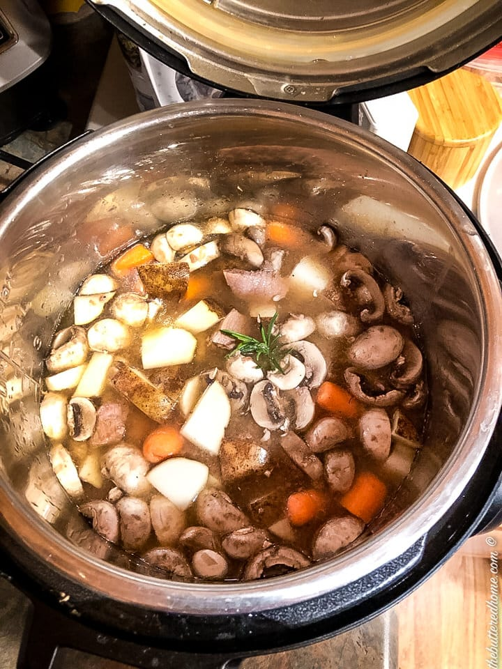 Ready to close the instant pot lid on rosemary beef stew