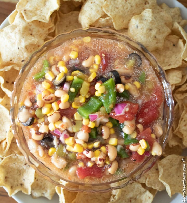 bowl of redneck caviar on a plate with tortilla chips