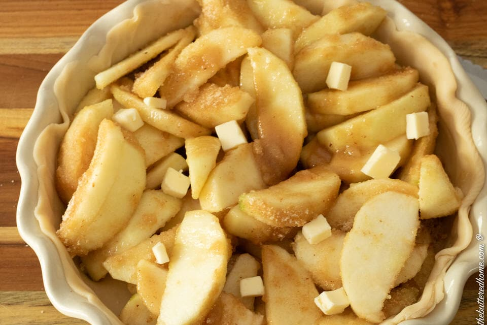 dots of butter inside apples