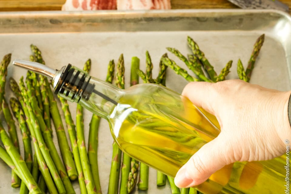 drizzling asparagus with olive oil