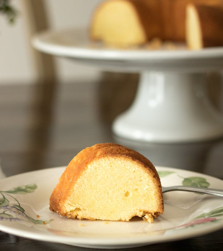 a slice of buttermilk pound cake on a floral plate