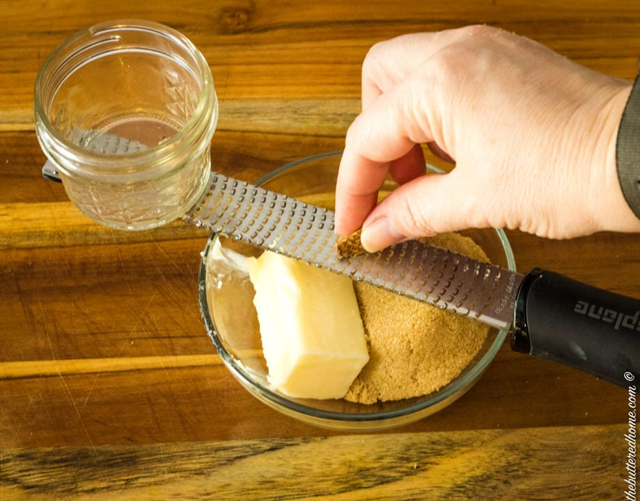 grating nutmeg with butter and brown sugar