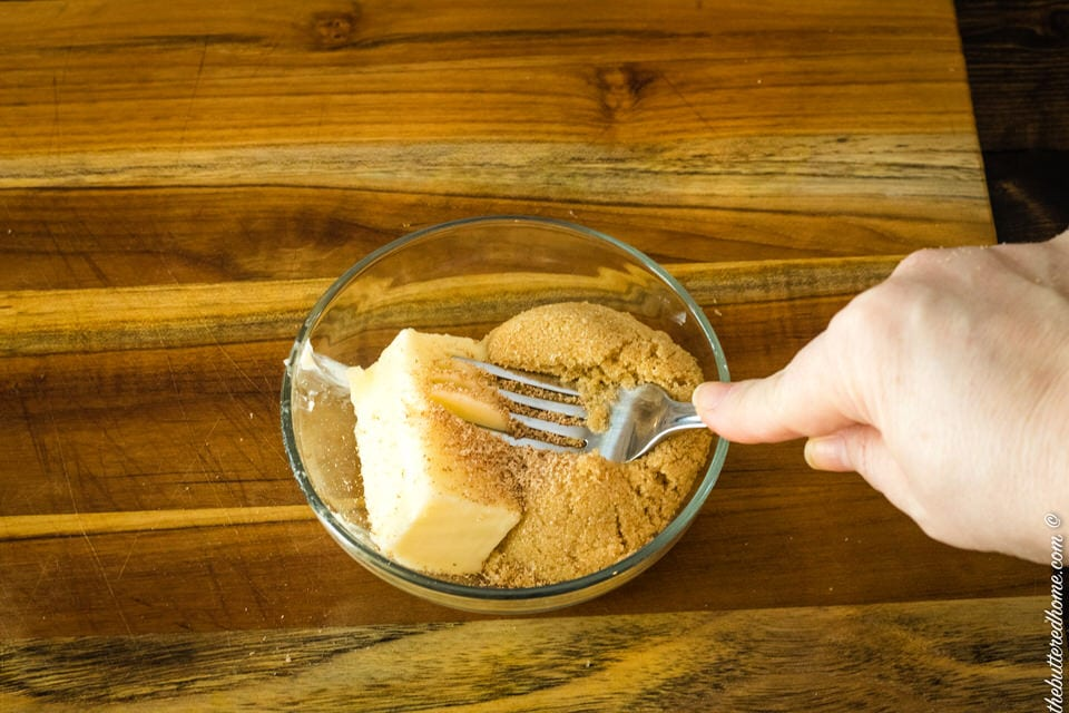 mashing topping ingredients together