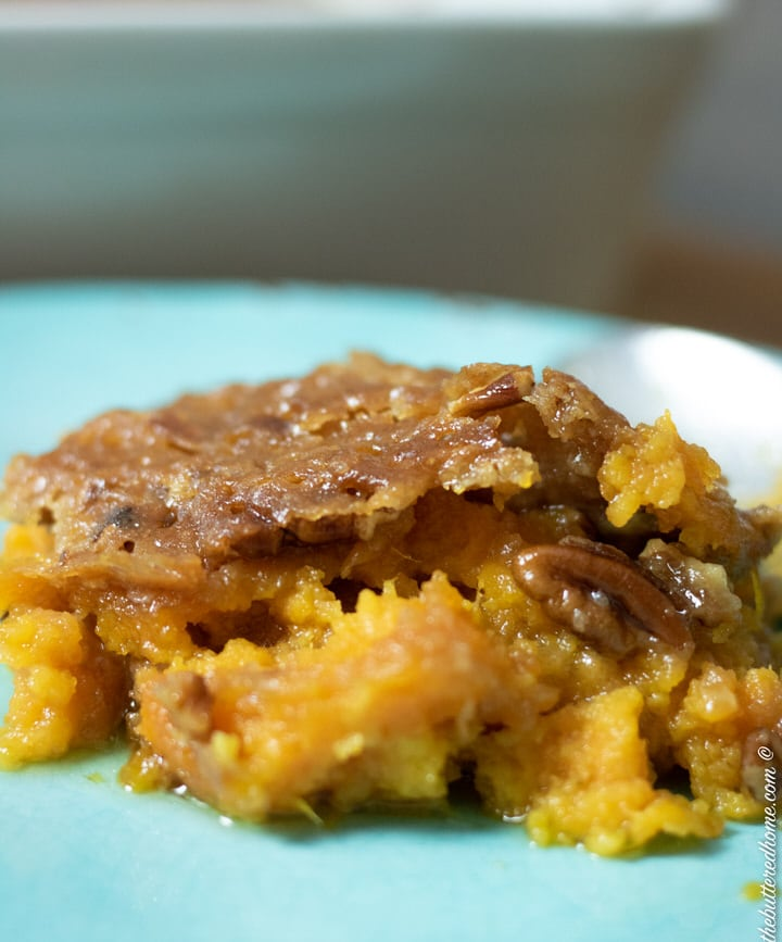 serving close up of sweet potato casserole on a blue plate