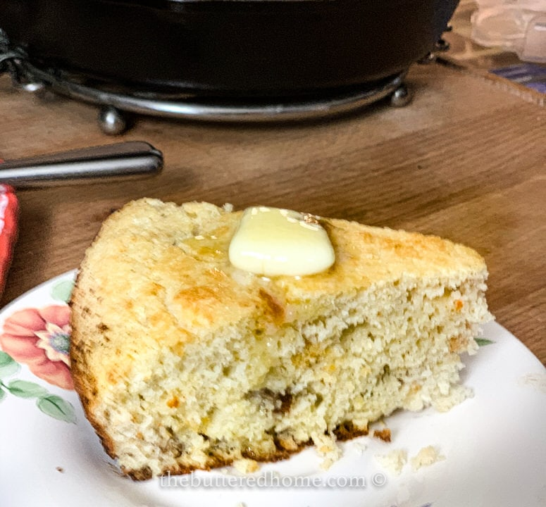 crackling bread slice with a pat of butter on a plate