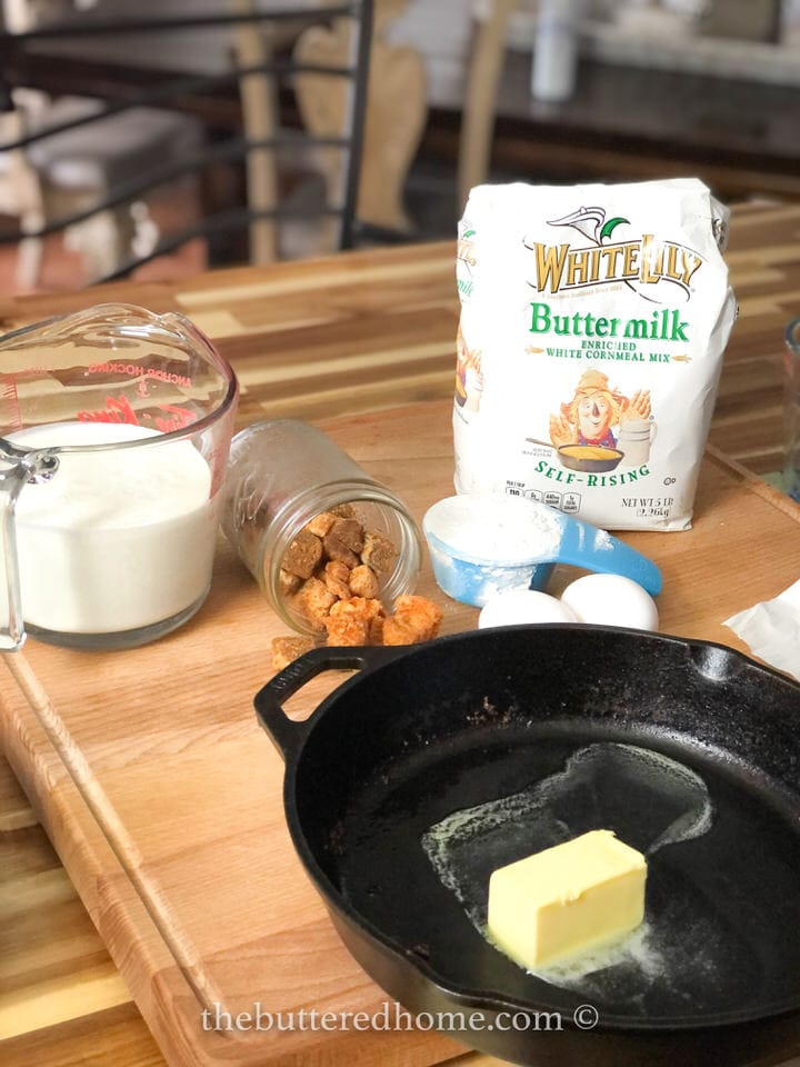cracklling bread ingredients with butter in iron skillet