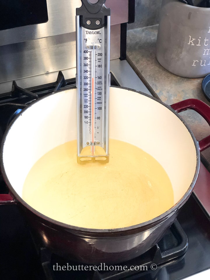 oil heating with thermometer in oil