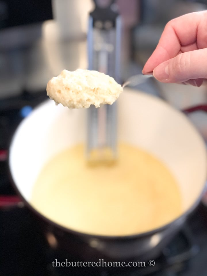 forming a small spoon of hush puppy dough