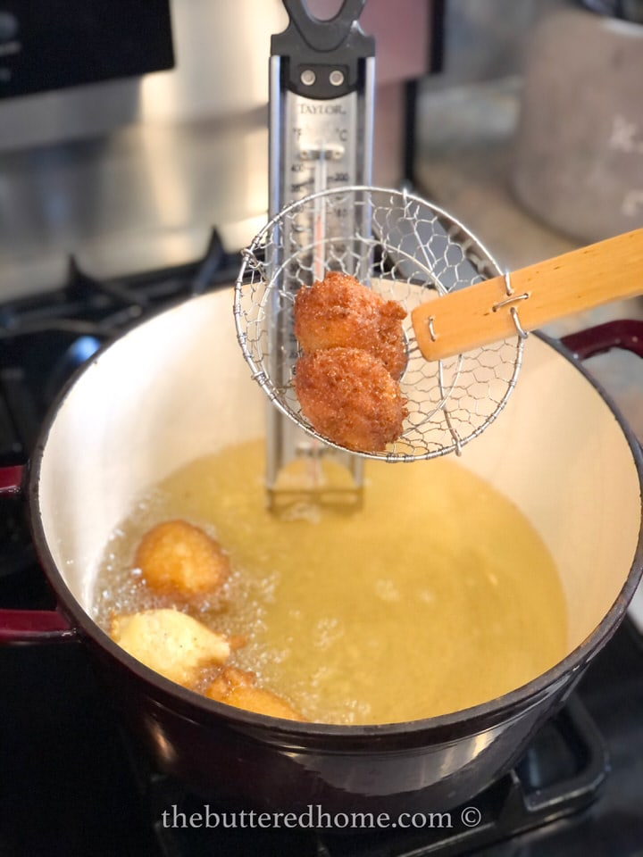 taking hush puppies out of frying oil