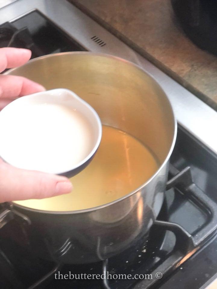 adding milk to cream