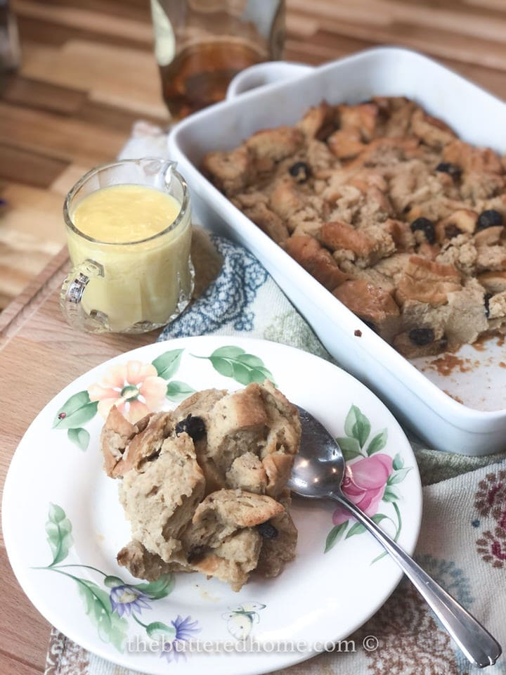 floral plate with bread pudding with cream on the side