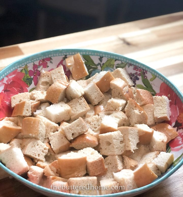 cubed bread in a floral bowl