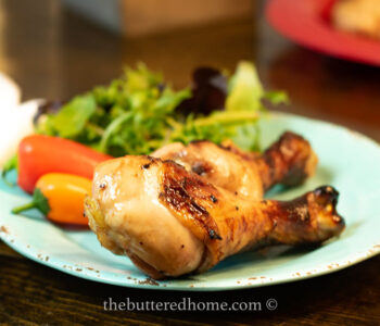 chicken legs bbq on a blue plate