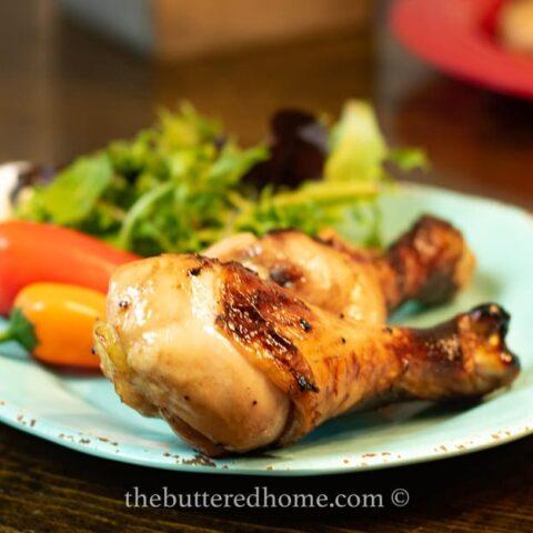 chicken legs bbq on a blue plate