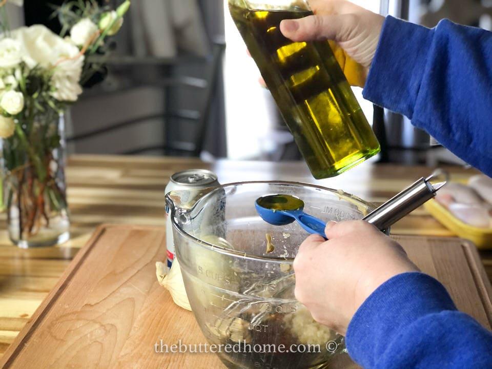 adding olive oil