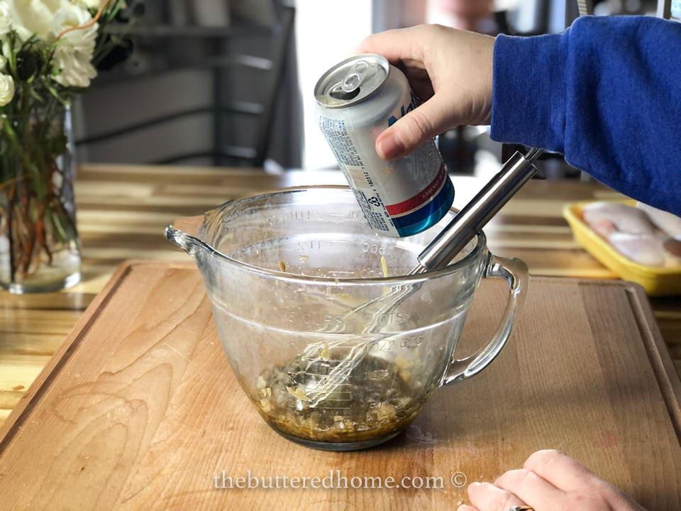 adding beer to marinade