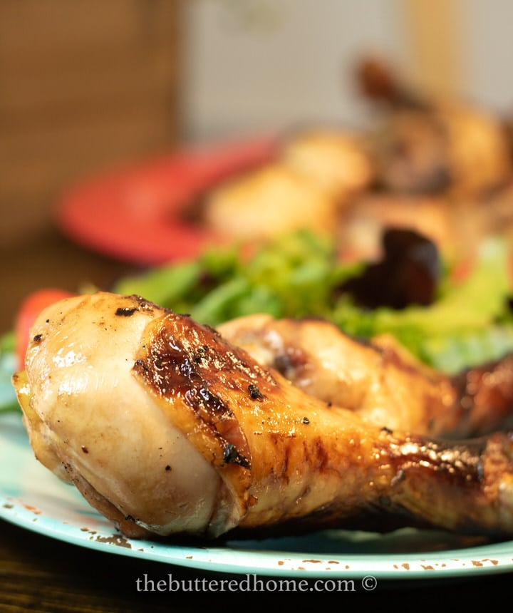Drunken chicken legs on a blue plate
