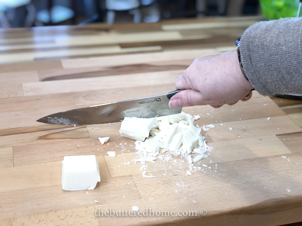 cutting up white chocolate bark