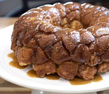 monkey bread with caramel sauce on cake plate