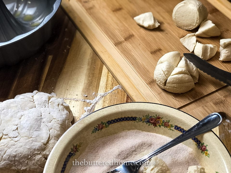 showing how to cut canned biscuits for monkey bread
