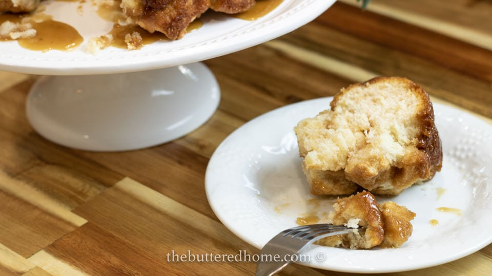 slice of monkey bread with a bite on a fork