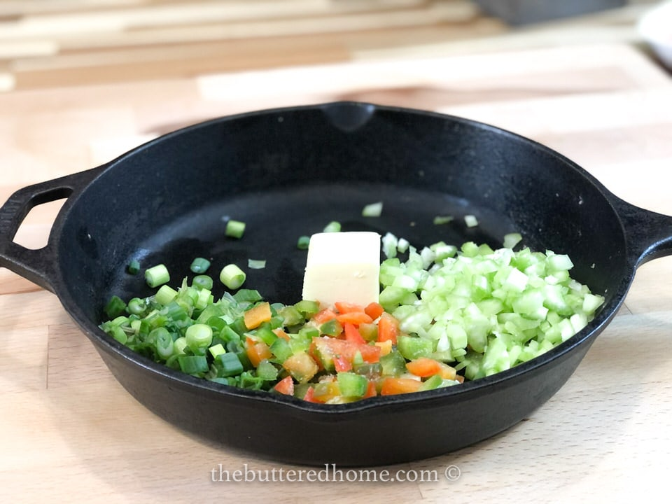 bell pepper, celery and onion in butter in pan