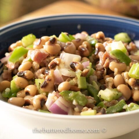 bacon black eyed pea salad in a blue bowl