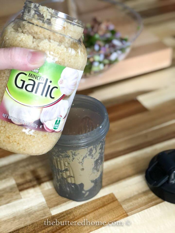 adding minced garlic