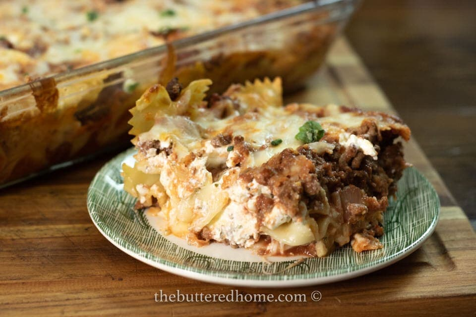 serving of beef pasta bake on a green and white dish