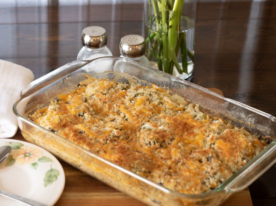 Broccoli and brown rice casserole in a clear pyrex dish